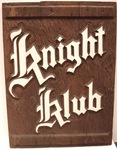 "Rough brown board with lettering on it ""Knight Club"""
