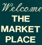 "Sign reading ""Welcome The Market Place"""
