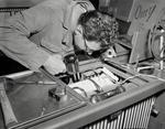 A technician repairs WBAY equipment by WBAY-TV