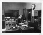 Employee inside the interior of Appleton WHBY master control by St. Norbert Abbey